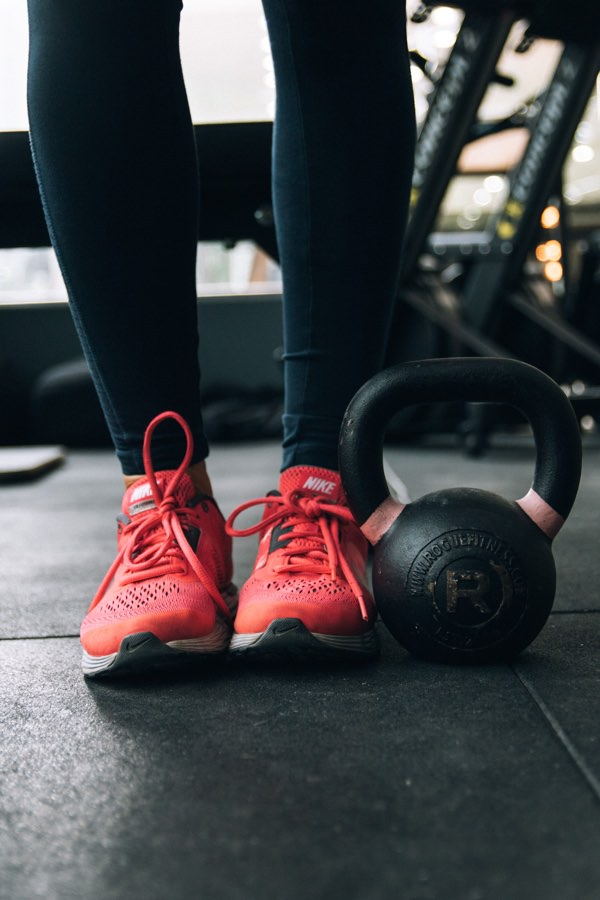 Fitness trainers and kettlebell weight
